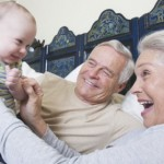 Image of Grandparents Playing with Grandchild
